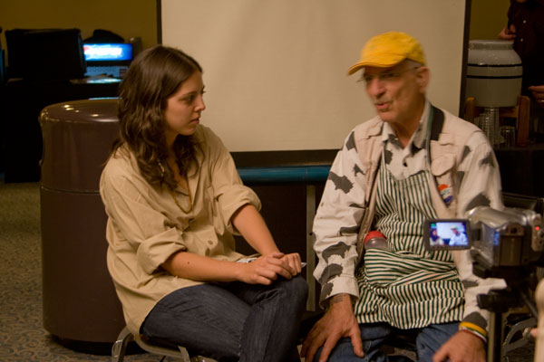 audience member being interviewed at a media station